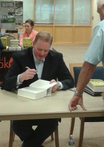 Dr. Luke Nichter signing a copy of his book, The Nixon Tapes