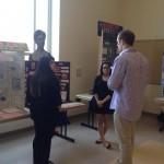 Alex Sycher judging History Day exhibits