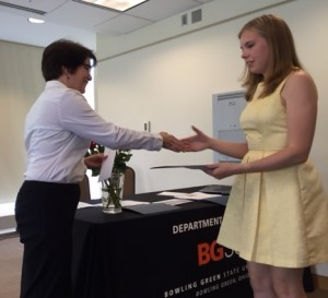 Dr. Rebecca Mancuso presents senior Allison Francis with the Undergraduate Research Excellence in History award.