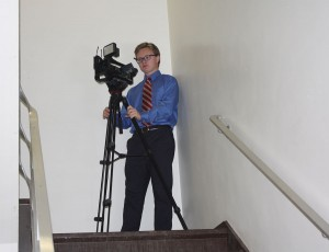 During the hands-on broadcast session, junior Patrick Arnold, from Ottawa Hills High School in Toledo, sets up a shot in the stairwell of West Hall.