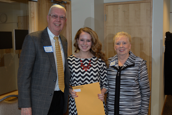 Rebecca Erwin, who received the Larry and Fran Weiss Journalism Scholarship, poses with Larry and Fran Weiss.