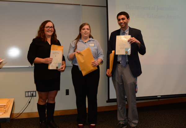 Lily Bartell, Hannah Benson and Gary Malveaux were inducted into the Kappa Tau Alpha honor society. Jeanette Benson (not pictured) was also inducted.