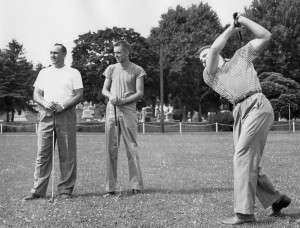 Three men playing golf.